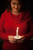 woman at a Christmas eve candle light service