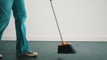 a man sweeping and mopping