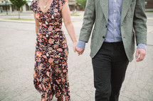 a couple walking holding hands
