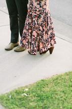 a couple walking on a sidewalk