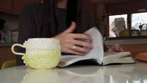 a woman sitting down to read a Bible