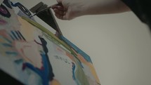 artist painting a canvas