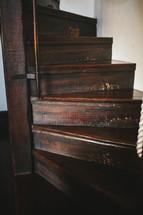narrow wood staircase