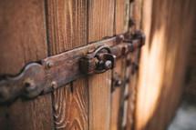 lock and hinge on a wooden door