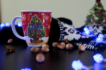 blue glowing string of lights and coffee mug