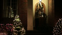 decorating a front door for Christmas