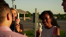 friends eating ice cream on a summer evening