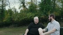 older man mentoring a younger man