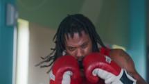 a boxer punching a punching bag