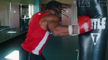 a boxer punching a punching bag