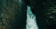 churning water flowing in a crevice