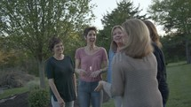 group of women talking outdoors