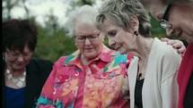 elderly women praying together