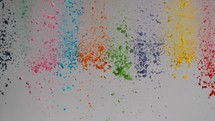 falling colorful powder on light background