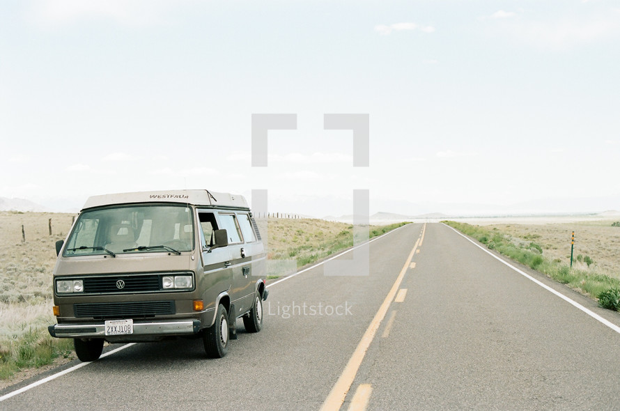 van parked on the side of a rural road