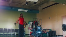 a man with a jump rope in the gym