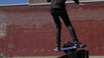 a person riding a one wheel skateboard