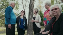 group of senior citizens talking