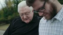 an older man mentoring a younger man