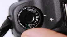 Setting mode dial lock button of the camera reflex - macro