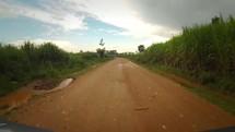 driving down a rural dirt road in Kenya