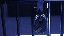 padlock on a prison cell