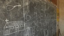 church and alphabet on a chalkboard in Kenya