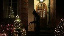 decorating the exterior of a home for Christmas