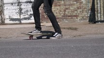 a man riding a skateboard downtown