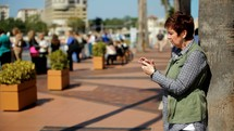 a woman scrolling through her cellphone