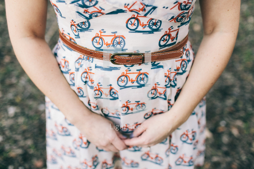 a woman in a vintage dress with bicycle print