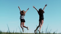 celebrating kids jumping up for joy