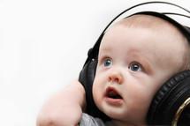 infant boy wearing headphones