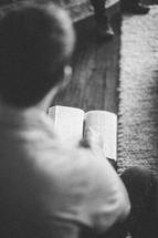 Man holding open Bible.