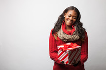 Woman holding a wrapped Christmas gift.
