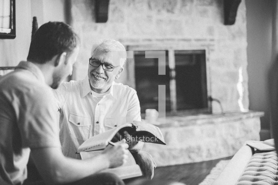men reading the Bible at a bible study