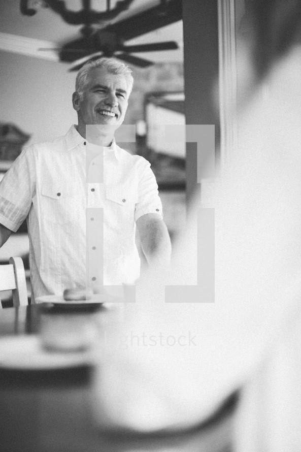 men in conversation in a kitchen