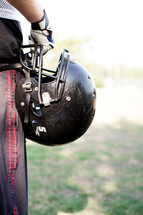 football player holding his helmet