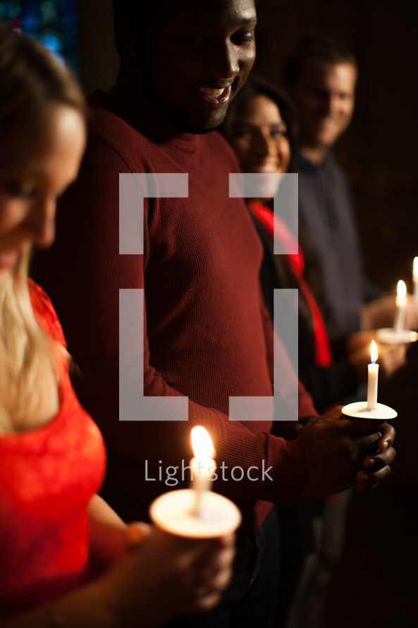 Parishioners holding candles at a Christmas Eve Service