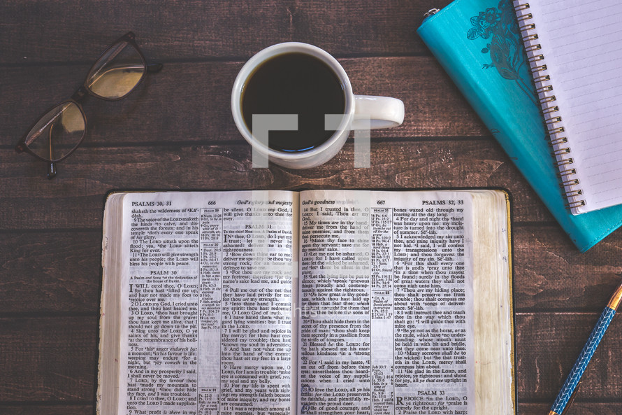 opened Bible and coffee