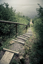 steps leading to a lake shore