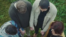 looking down into a group holding hands in prayer