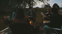 friends sitting around a fire