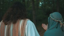Jesus walking with Mary