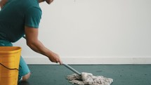 a man mopping a floor