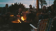friends roasting marshmallows around a fire
