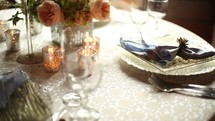 elegant place settings on a table at a wedding reception