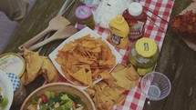 food on a picnic table at a cookout