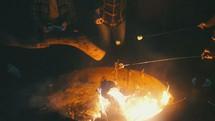 friends roasting marshmallows around a fire