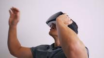 a man using VR glasses
